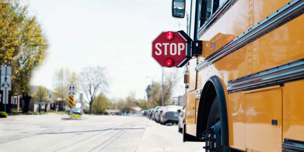 School bus stopped in neighborhood.
